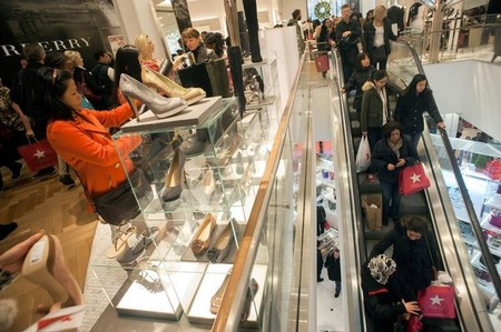 FILE PHOTO: Shoppers look over shoes on sale at a Macy's store in New York