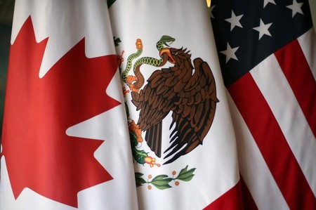 FILE PHOTO: Flags are pictured during the fifth round of NAFTA talks involving the United States, Mexico and Canada, in Mexico City