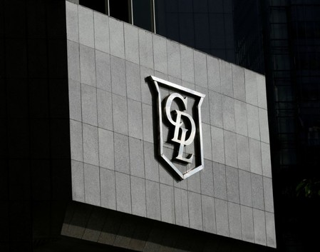A City Developments Limited (CDL) logo is ssen on a building in Singapore