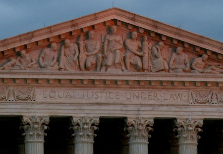 FILE PHOTO: The top of U.S. Supreme Court building is lit at dusk in Washington