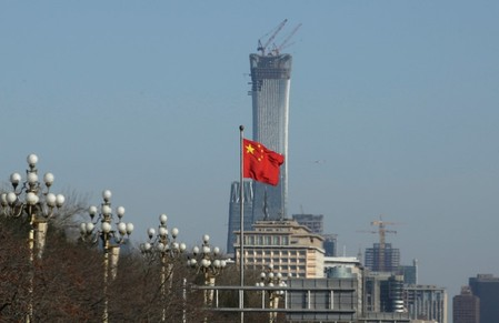 A Chinese flag flutters at Xinhuamen Gate of Zhongnanhai leadership compound in central Beijing