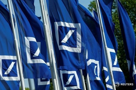 Flags with the logo of Deutsche Bank are seen at the headquarters ahead of the bank's annual general meeting in Frankfurt