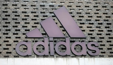 The logo of Adidas is seen on an outlet store in Metzingen