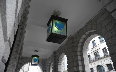 The logo of Barclays bank is seen on glass lamps outside of a branch of the bank in the City of London financial district in London