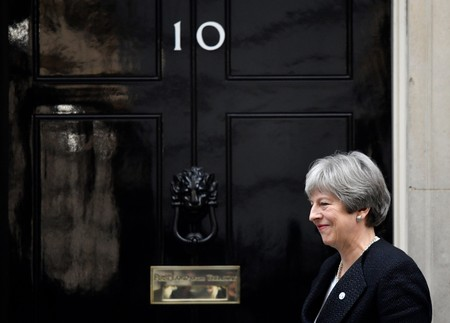 Britain's Prime Minister Theresa May walks out of 10 Downing Street to greet the Prime Minister of Estonia, Juri Ratas in London