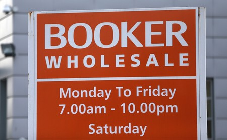 FILE PHOTO:A branded sign is displayed outside of a Booker Wholesale store in London