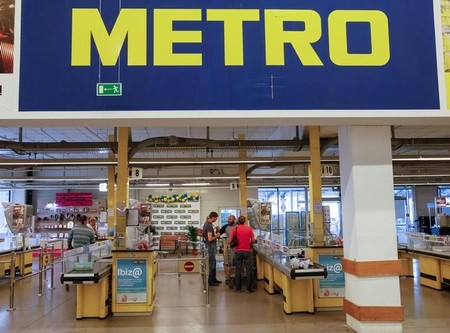 Customers are seen at cash desk of Metro cash and carry store in Kiev
