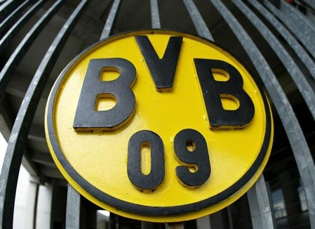 A picture shows the Borussia Dortmund logo at an entrance of the Westfalenstadion in the western Ger..