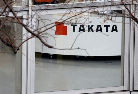 FILE PHOTO: Logo of Takata Corp is seen on its display at a showroom for vehicles in Tokyo
