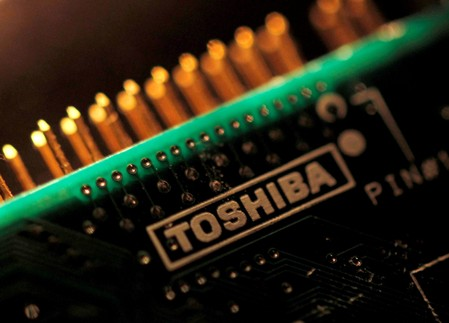 FILE PHOTO: A logo of Toshiba Corp is seen on a printed circuit board in this photo illustration taken in Tokyo