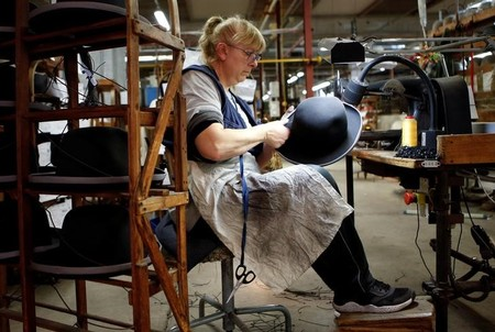 An employee works on a Borsalino hat in the factory in Alessandria