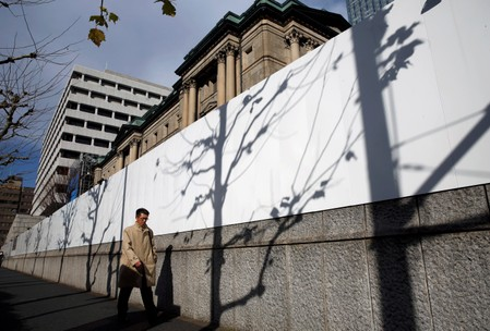 Man walks past the Bank of Japan building in Tokyo