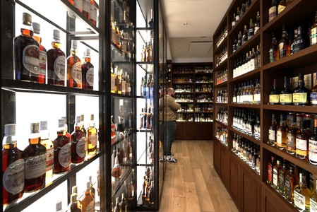 Whisky bottles are displayed for sale in La Maison du Whisky boutique in Paris