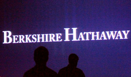 FILE PHOTO: Berkshire Hathaway shareholders walking by a video screen at the company's annual meeting in Omaha