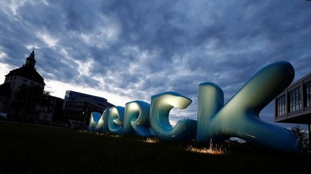 The logo of German pharmaceuticals company Merck is seen in front of the company's headquarters in Darmstadt