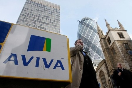 FILE PHOTO: Pedestrians walk past an Aviva logo outside the company's head office in the city of London