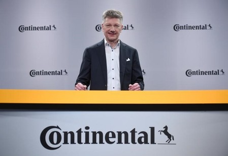 Elmar Degenhart, CEO of German tyre company Continental, poses for the media before the annual news conference in Hanover