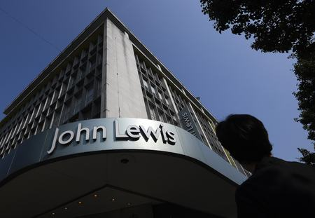 FILE PHOTO: Shoppers pass a branch of John Lewis in London
