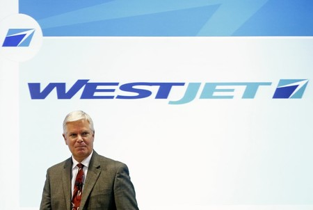 WestJet CEO Saretsky walks on stage at their annual general meeting for shareholders in Toronto