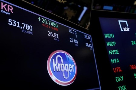 A logo of Kroger is displayed on a monitor above the floor of the New York Stock Exchange shortly after the opening bell in New York