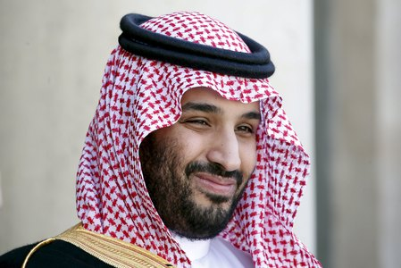 FILE PHOTO:Saudi Arabia's then Deputy Crown Prince Mohammed bin Salman reacts upon his arrival at the Elysee Palace in Paris