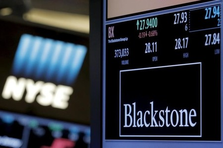 FILE PHOTO - The ticker and trading information for Blackstone Group is displayed at the post where it is traded on the floor of the New York Stock Exchange