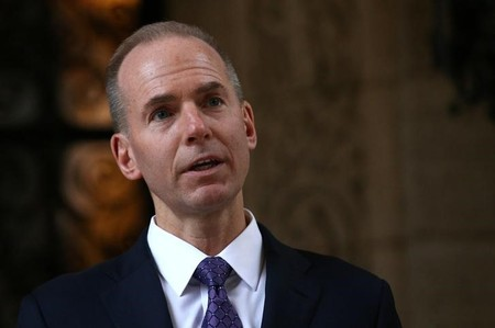 FILE PHOTO - Boeing CEO Dennis Muilenburg leaves  talks to members of the media after a meeting with U.S. President-elect Donald Trump at Mar-a-Lago estate in Palm Beach, Florida, U.S.