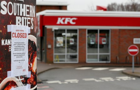 FILE PHOTO - A closed sign hangs on the drive through of a KFC restaurant after problems with a new distribution system in Coalville