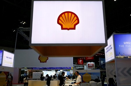 FILE PHOTO - Staff members work at the booth of Royal Dutch Shell at Gastech, the world's biggest expo for the gas industry, in Chiba