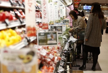 Shoppers browse vegetables at a supermarket in Chiba