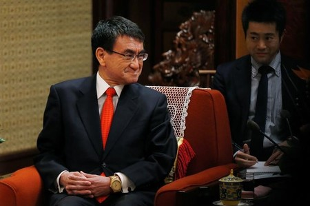 Japanese Foreign Minister Taro Kono listens to Chinese Premier Li Keqiang during their meeting at the Zhongnanhai Leadership Compound in Beijing