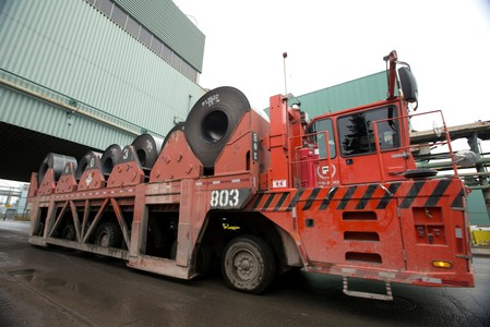 Rolls of steel are moved outside the ArcelorMittal Dofasco plant in Hamilton