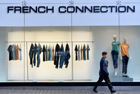 A person walks past a French Connection store in London, Britain