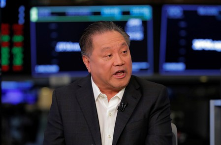 Hock Tan, CEO of Broadcom, speaks on the floor of the New York Stock Exchange shortly before the opening bell in New York