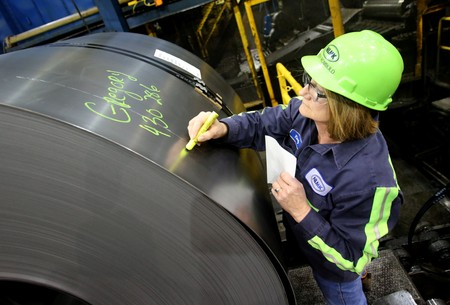 A finished steel coil is marked with its information by a worker at the Novolipetsk Steel PAO steel mill in Farrell