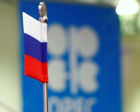 The Russian flag and the OPEC logo are seen before a news conference in Vienna