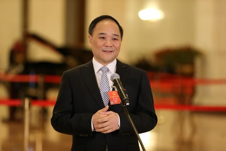 NPC delegate and Geely Chairman Li Shufu talks to the media before the closing session of the National People's Congress (NPC), at the Great Hall of the People in Beijing