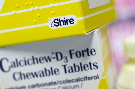 FILE PHOTO: Vitamins made by Shire are displayed at a chemist's in northwest London