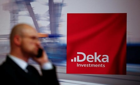 A banker makes a phone call next to the logo of Deka Investments department of German Sparkasse savings banks in Duesseldorf