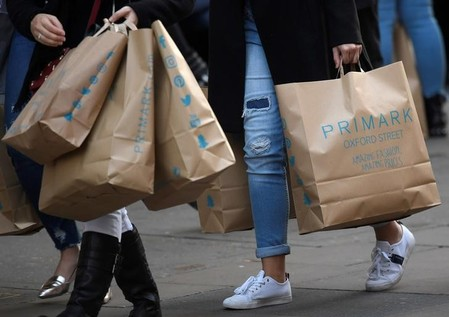 Shoppers carry Primark bags in central London, Britain