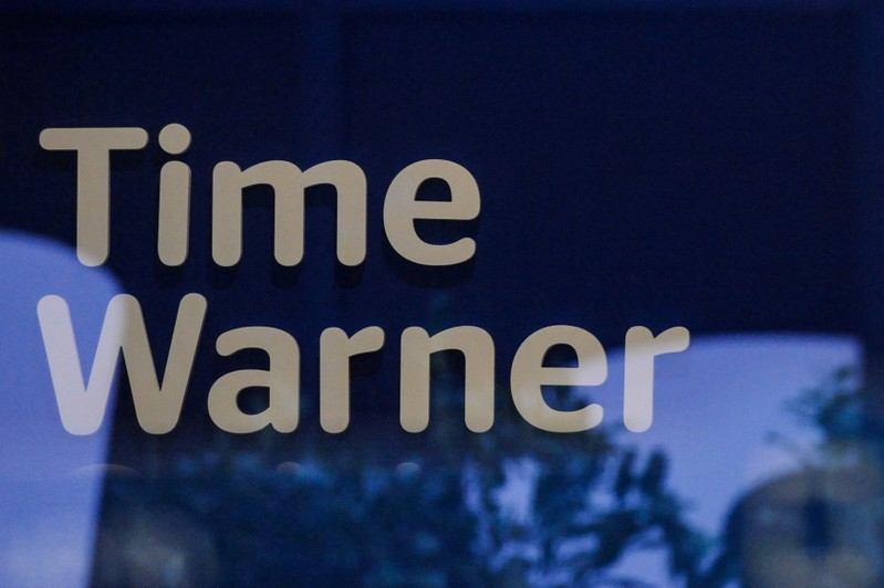 FILE PHOTO: A Time Warner logo is seen at a Time Warner store in New York City