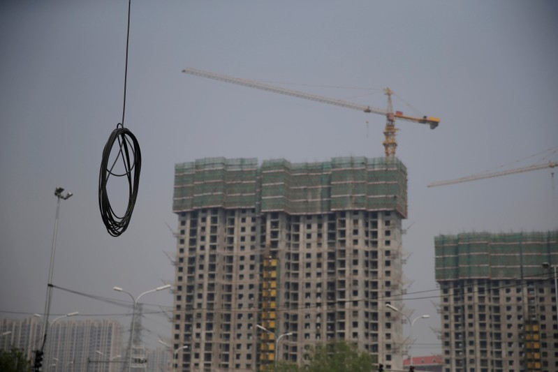FILE PHOTO: A cable is seen near residential buildings under construction in Beijing
