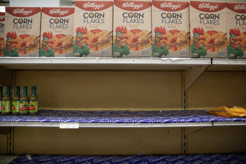 Boxes of corn flakes made by Kellogg are seen on a shelf inside al local shop in Caracas