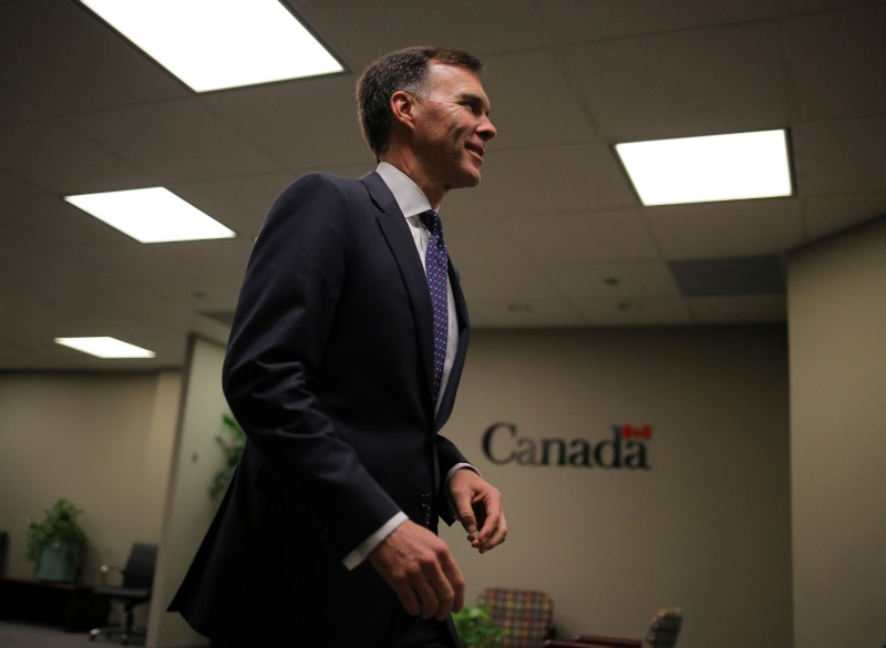 FILE PHOTO: Canada's Finance Minister Bill Morneau walks through his office to hold a news conference on the state of the Kinder Morgan pipeline expansion
