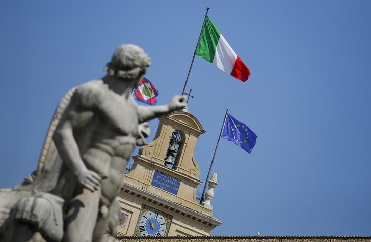 The Italian national flag flutters atop of the Quirinale presidential palace in Rome