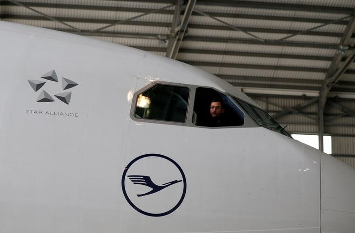 A technician looks out of the cockpit of a Lufthansa Airbus A330-300 aircraft in a maintenance hangar at Lufthansa Technik Malta at Malta International Airport outside Luqa