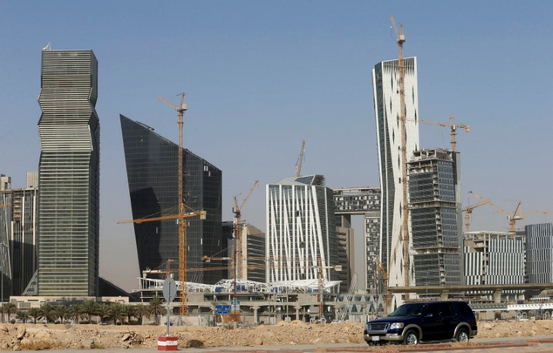 A vehicle drives past the King Abdullah Financial District in Riyadh