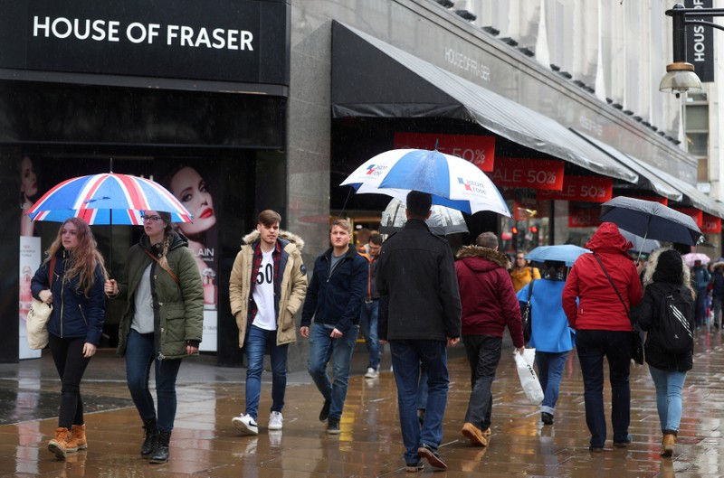 FILE PHOTO: Shoppers walk past House of Fraser on Oxford Street in central London