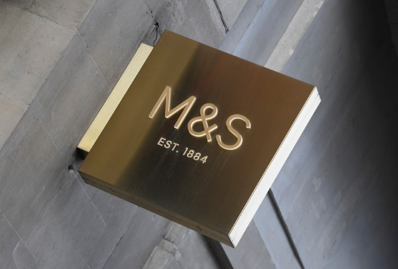 A sign is seen on the exterior of a branch of Marks and Spencer in central London, Britain