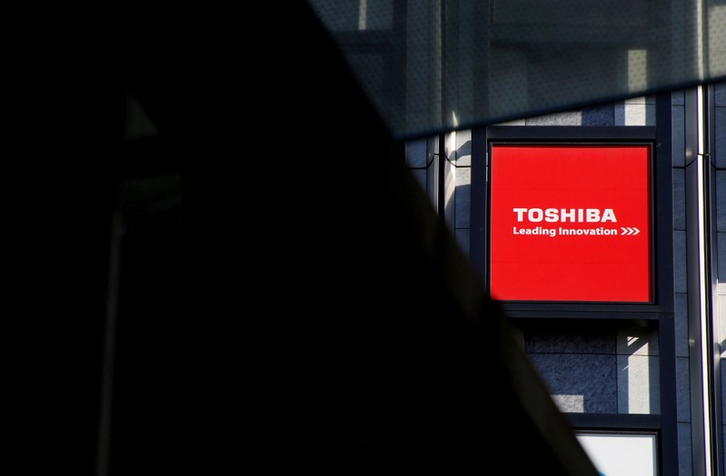 FILE PHOTO: A logo of Toshiba Corp is seen outside an electronics retail store in Tokyo